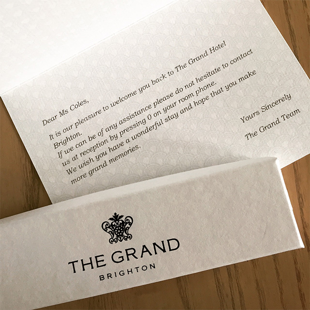 The Grand Hotel card and chocolates