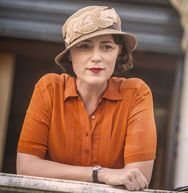 Louisa Durrell orange shirt